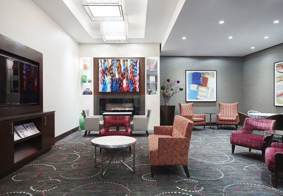 property building living room Lobby Fireplace recreation room home condominium