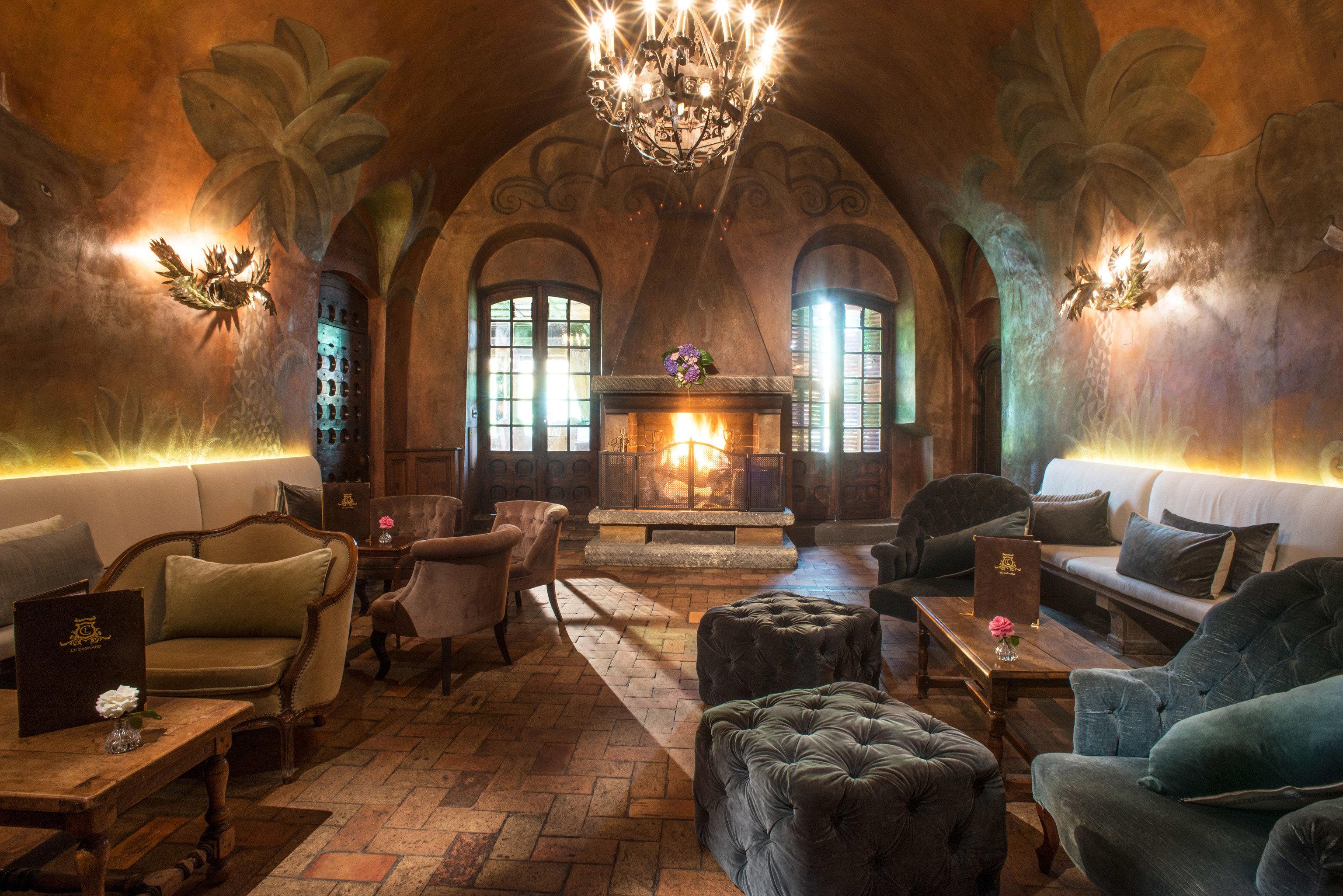 sofa property Fireplace building living room mansion Lobby home lighting screenshot hacienda stone