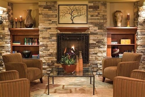 sofa living room chair Fireplace property home hardwood hearth cabinetry wood flooring cottage Lobby flooring
