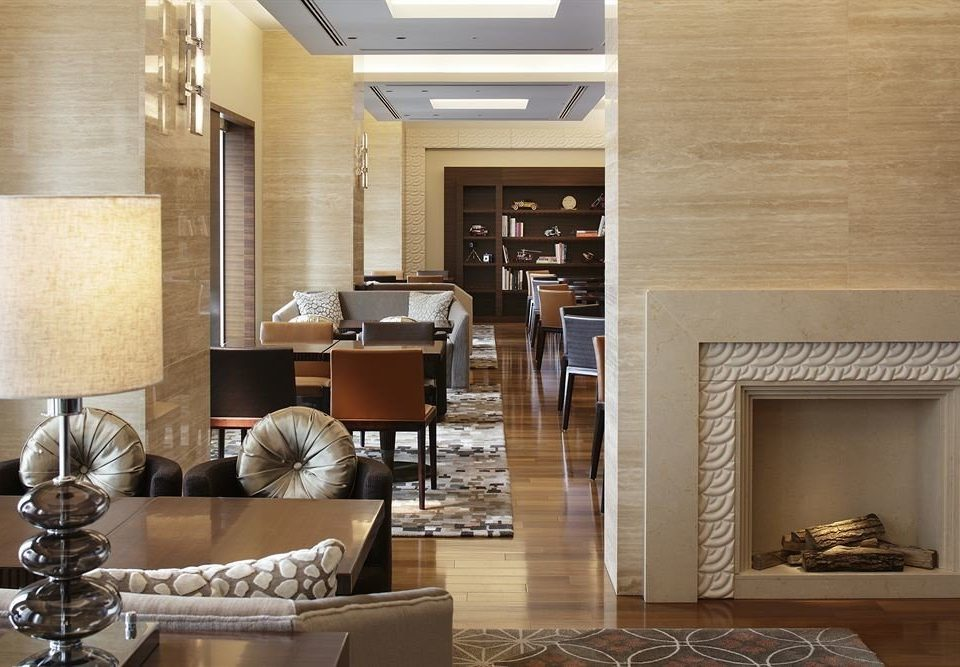 living room property home Fireplace hardwood cabinetry flooring Lobby hearth wood flooring