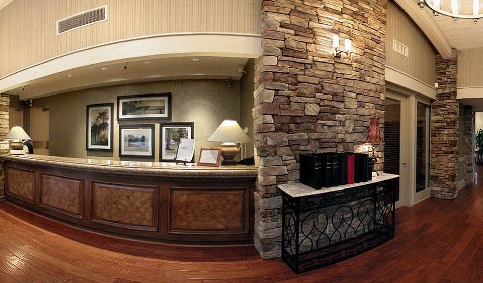 property Lobby home Fireplace mansion living room cabinetry stone