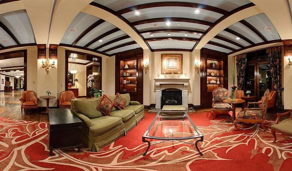 chair Lobby living room Fireplace home mansion flooring leather