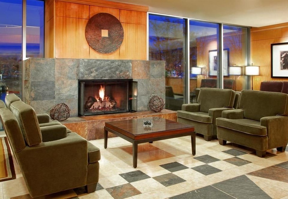 living room Fireplace property hearth home hardwood flooring cottage wood flooring Lobby stone