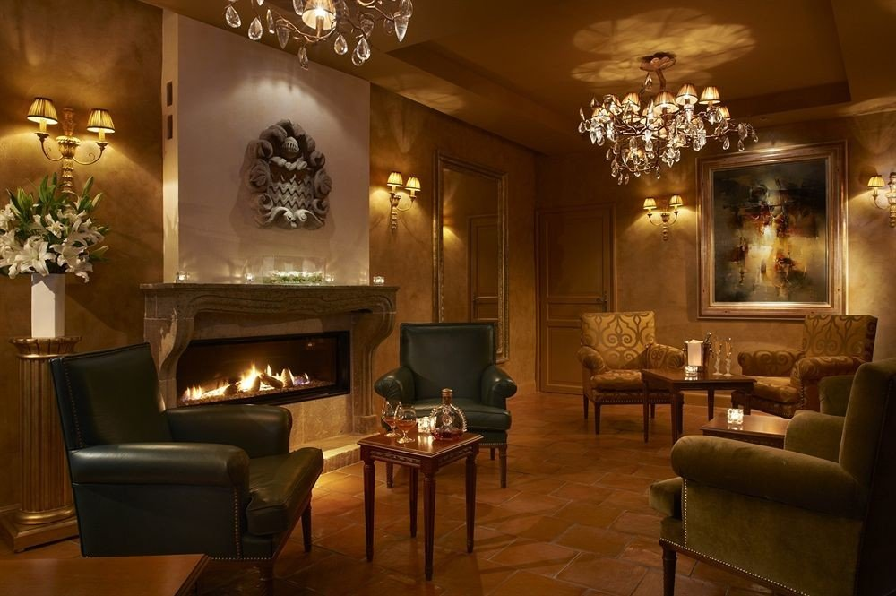 property Fireplace fire Lobby living room lighting home mansion fancy