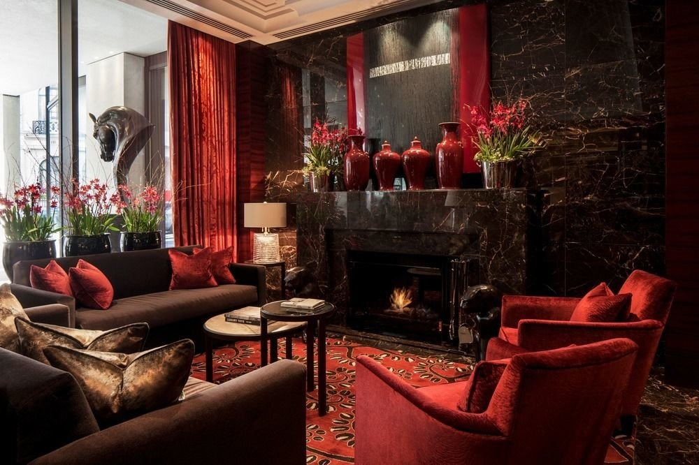 sofa red living room property fire home Fireplace Lobby restaurant leather