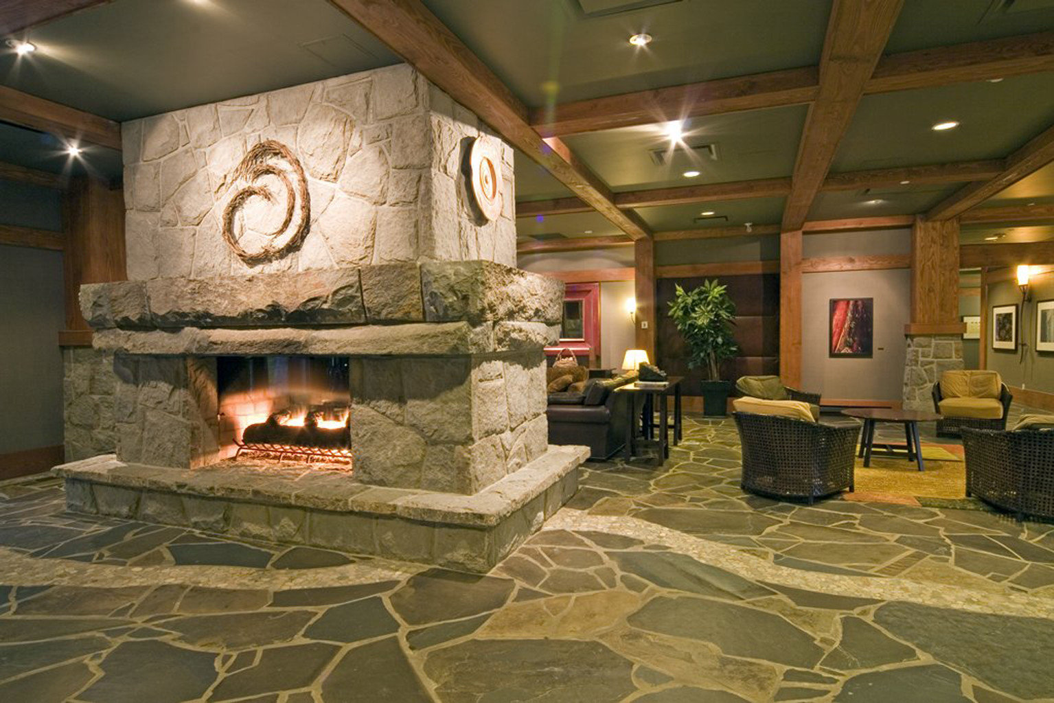 Lobby Lodge Lounge Mountains Outdoor Activities Scenic views building Fireplace home hearth living room flooring stone old