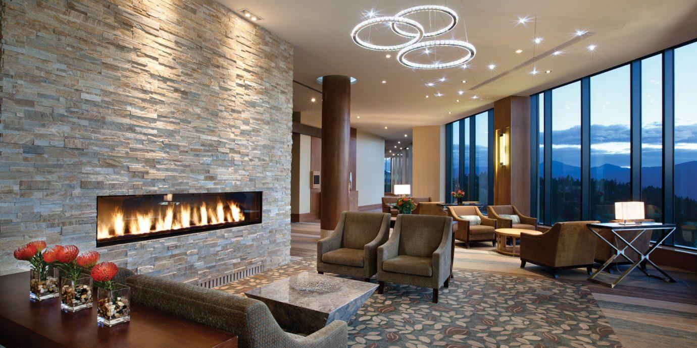 Fireplace Lodge Lounge Modern Mountains Resort Romance Romantic Scenic views property Lobby living room condominium Suite stone