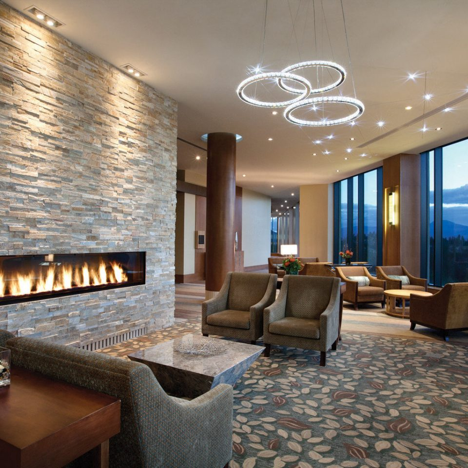 Fireplace Lodge Lounge Modern Mountains Resort Romance Romantic Scenic views property Lobby living room condominium Suite stone