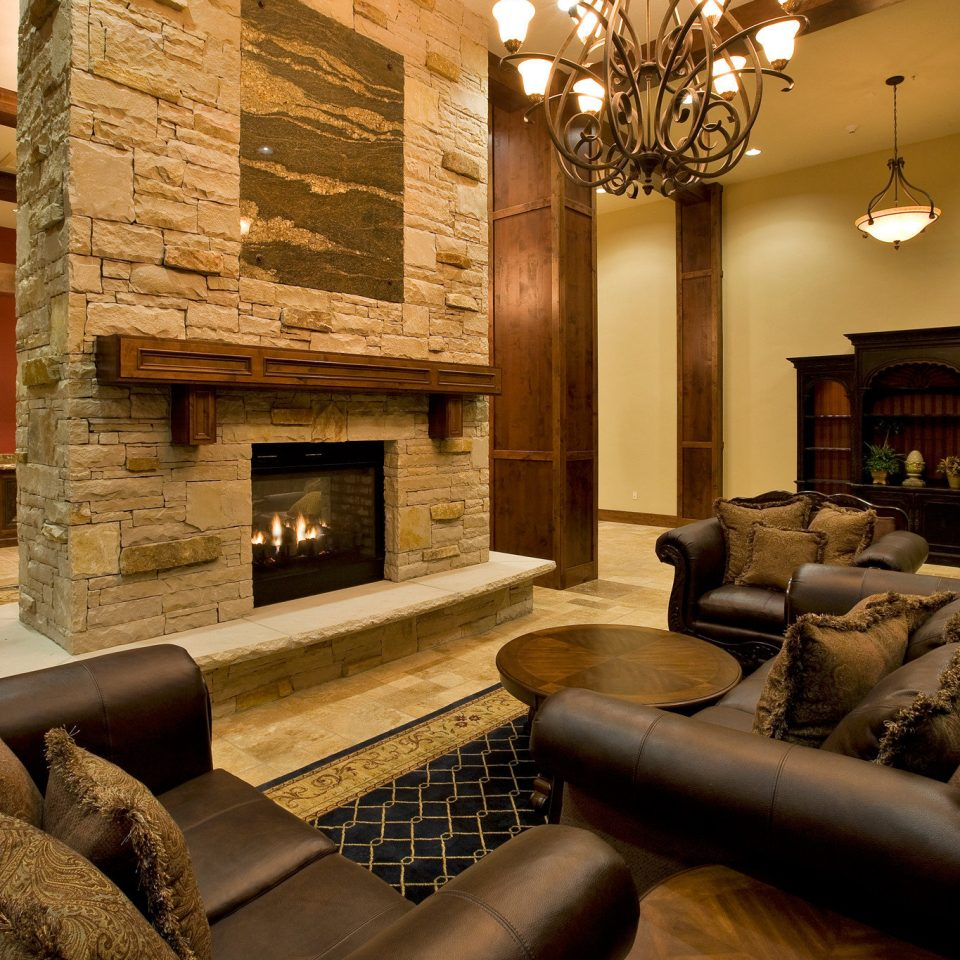 Fireplace Lounge Luxury property living room home Lobby lighting mansion stone leather