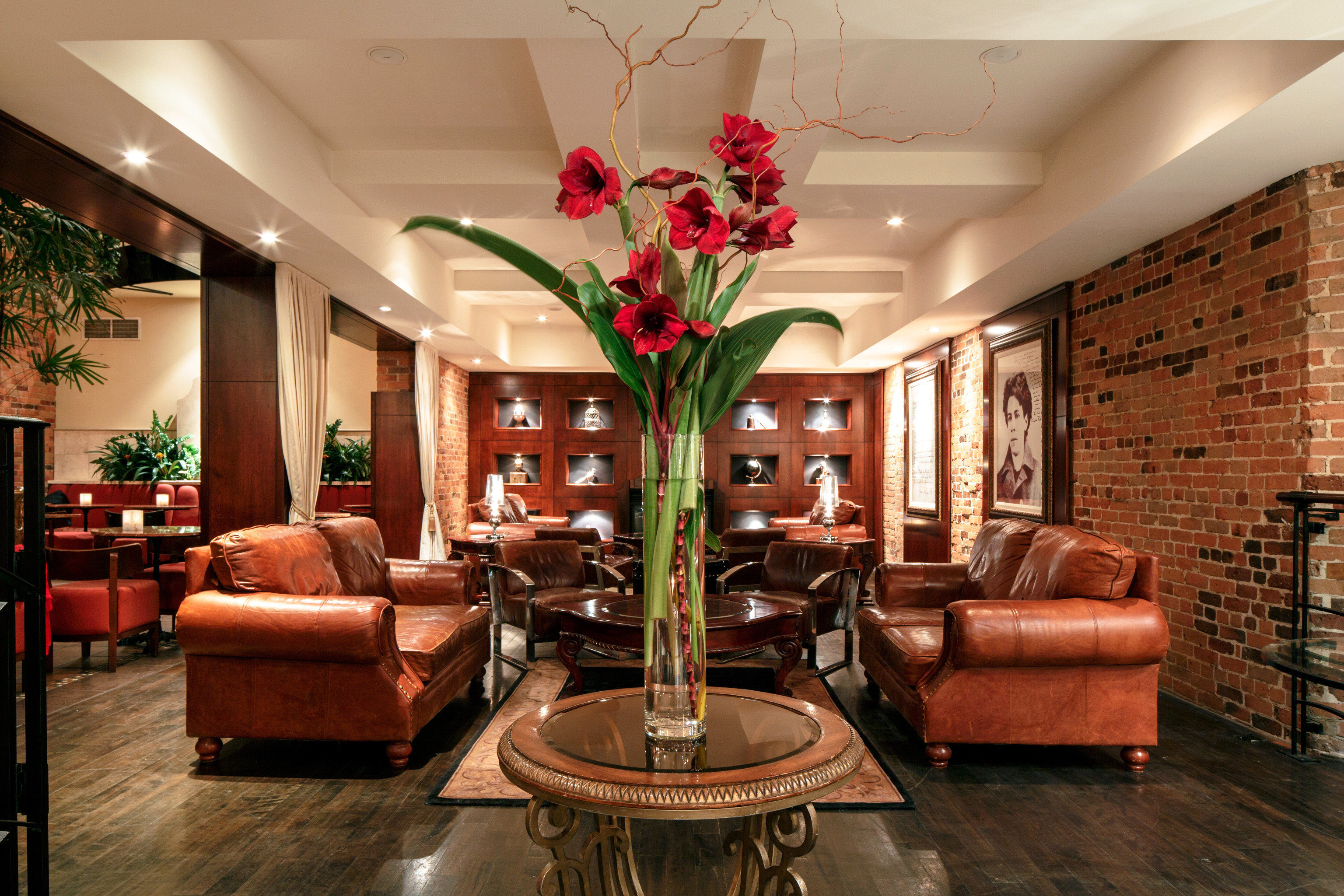 Lobby Lounge Luxury Trip Ideas Weekend Getaways Winter living room property home hardwood Fireplace plant mansion stone leather