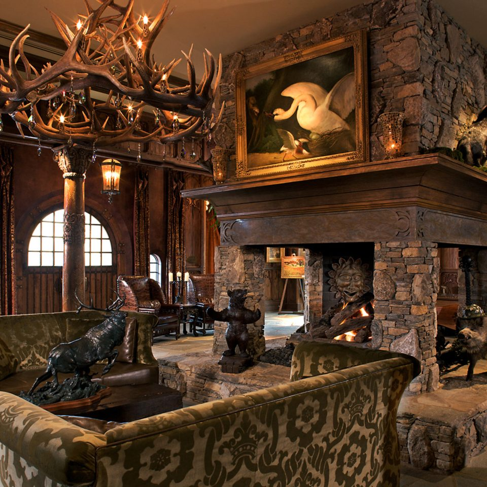 Fireplace Lounge Luxury Rustic sofa fire property building living room home house mansion lighting stone Lobby restaurant farmhouse cottage altar