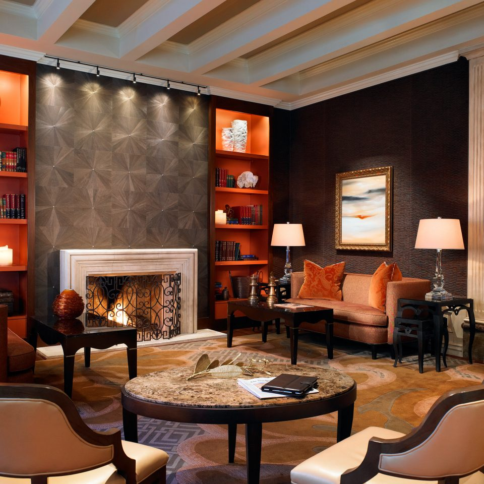 Fireplace Lounge Luxury Modern living room chair property home Lobby recreation room Suite condominium