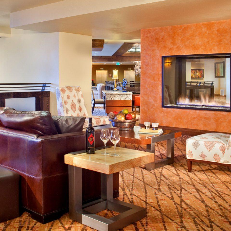 Fireplace Lobby Lounge Modern living room property home hardwood Suite condominium Villa cottage