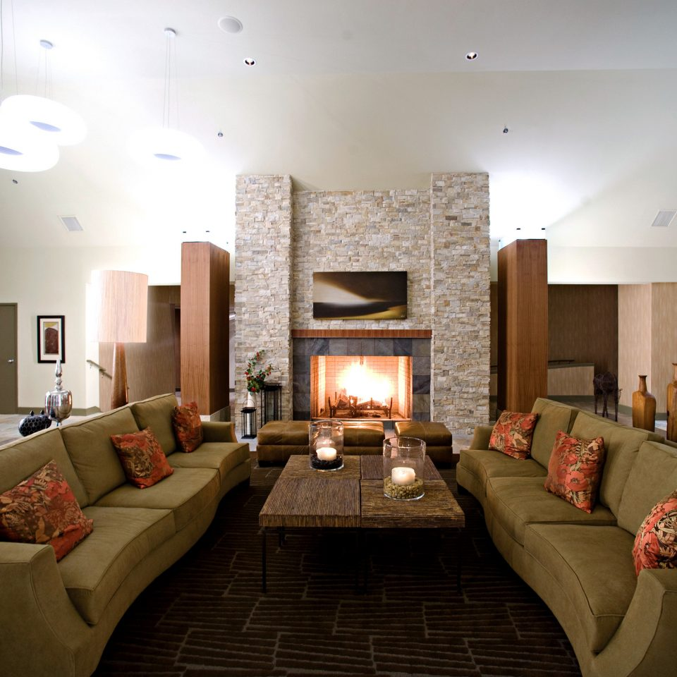 Fireplace Lounge Resort Rustic sofa property living room Suite home Lobby condominium