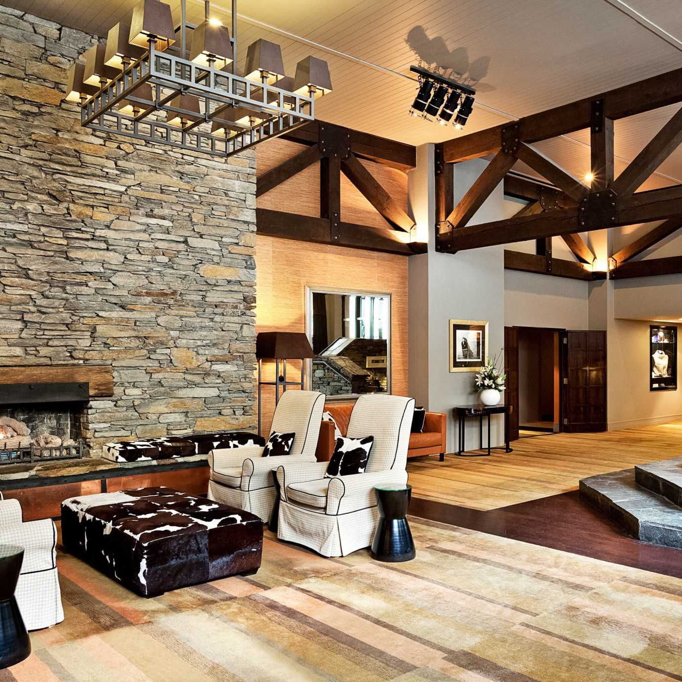 Fireplace Lounge property living room hardwood home farmhouse wood flooring flooring cottage mansion Villa Lobby loft stone