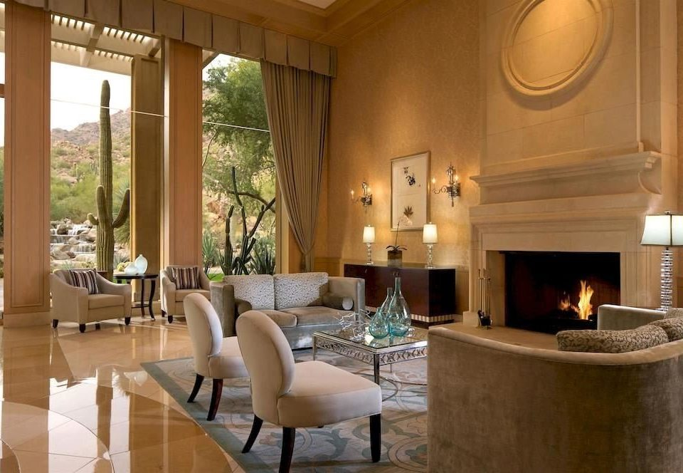 property Lobby living room Fireplace home Suite Resort Villa mansion condominium