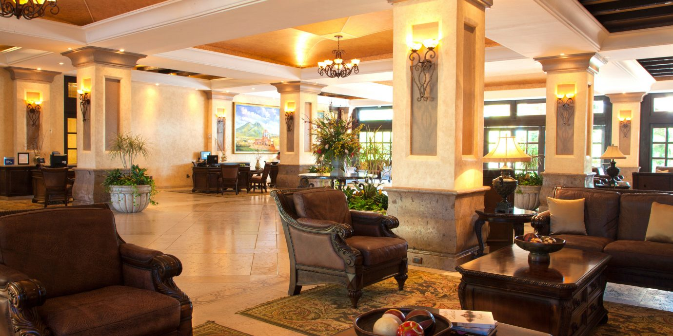 sofa Lobby property living room home Fireplace condominium Resort mansion Villa leather
