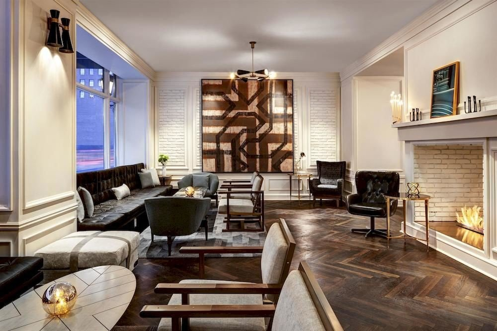living room property Fireplace home condominium hardwood Lobby Suite loft