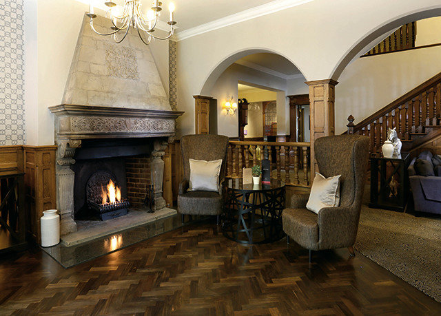 property Lobby living room mansion home Fireplace palace Villa cottage hacienda Suite flooring stone tile