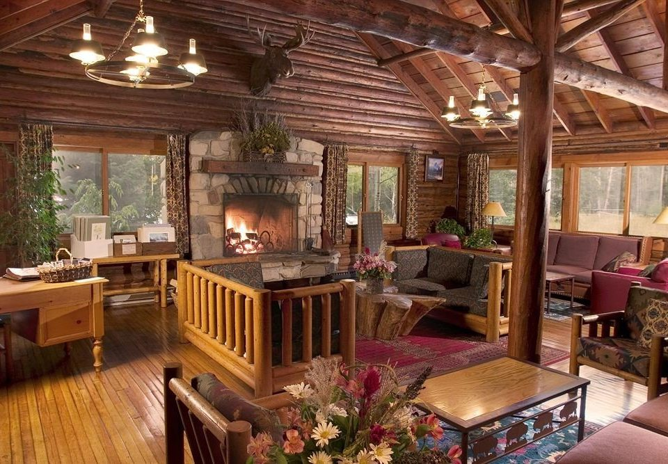 Fireplace Lodge Lounge Romantic property living room log cabin home wooden cottage mansion farmhouse recreation room porch Villa outdoor structure Resort