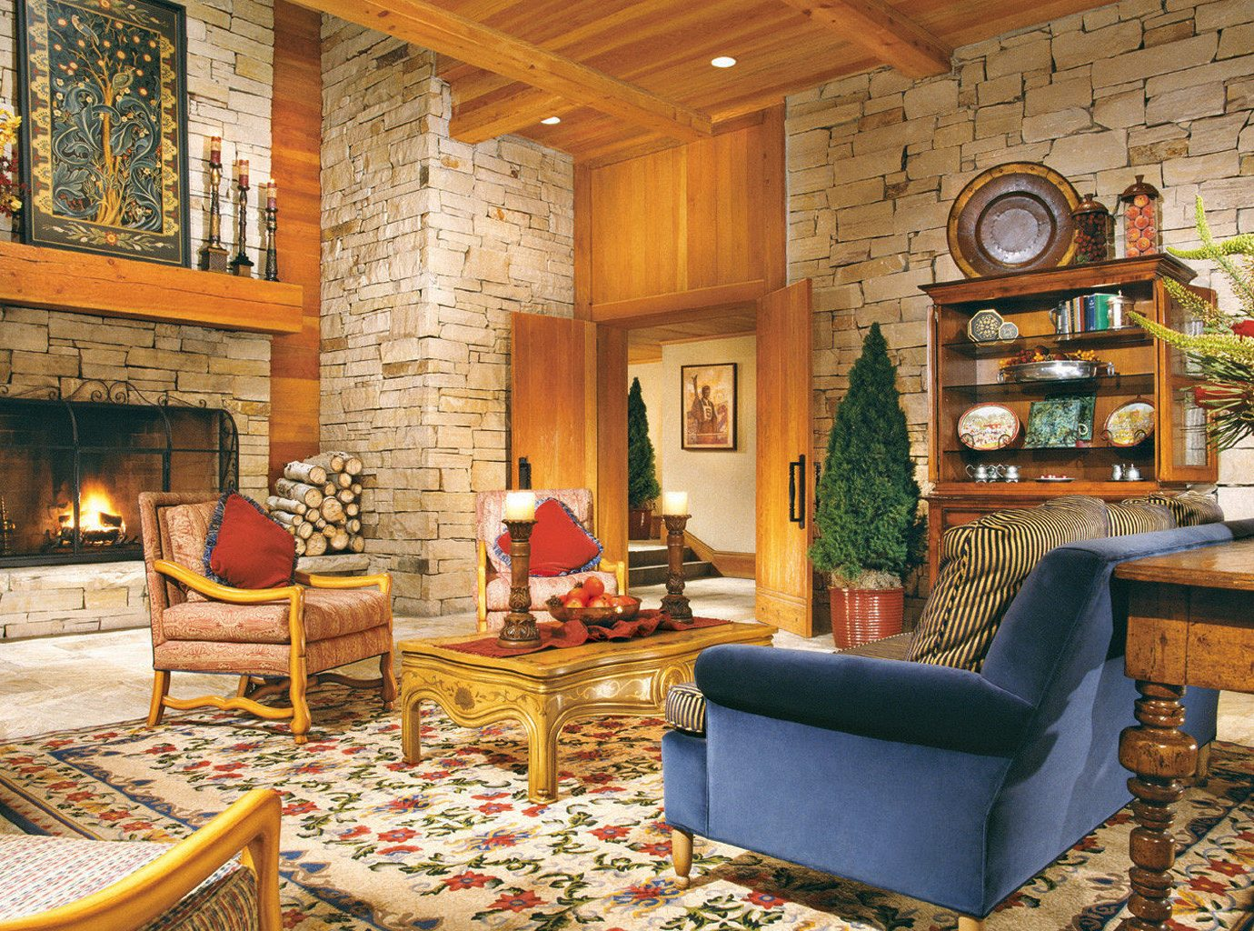 Fireplace Lodge Lounge Rustic living room property home cottage farmhouse log cabin mansion recreation room