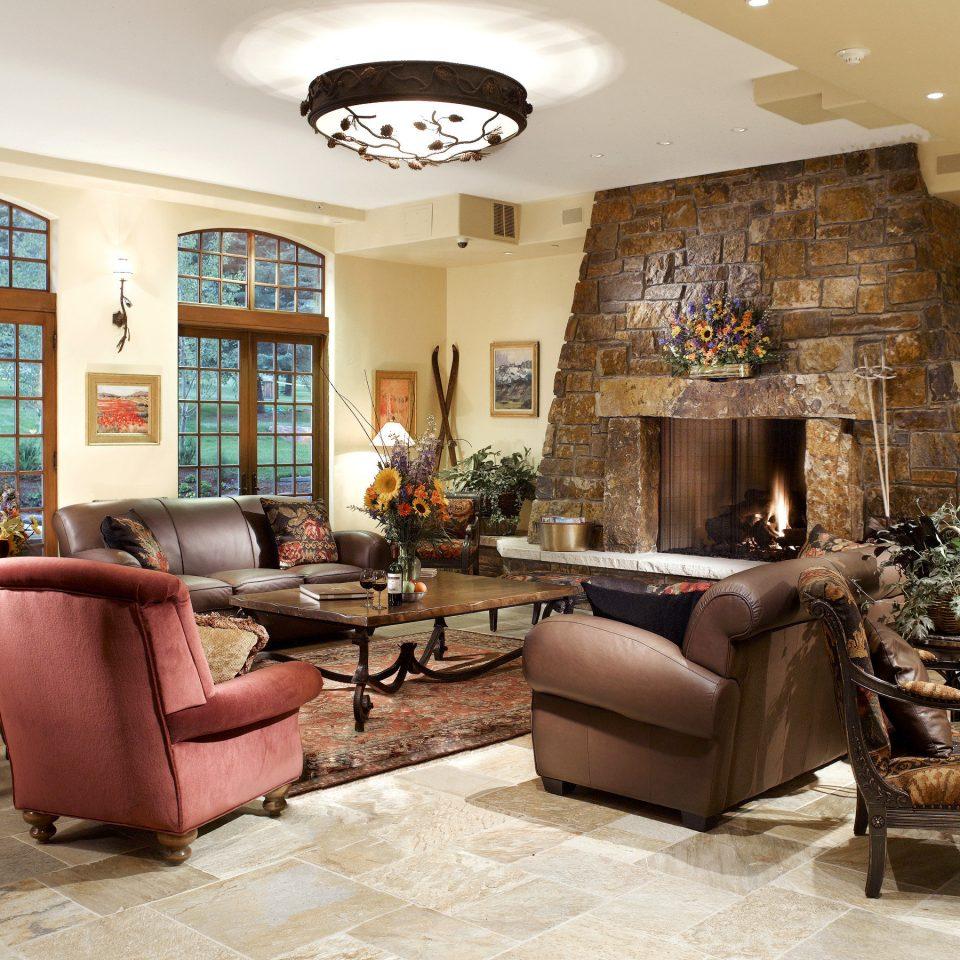Fireplace Lodge Lounge sofa living room chair property home hardwood condominium mansion cottage Villa farmhouse