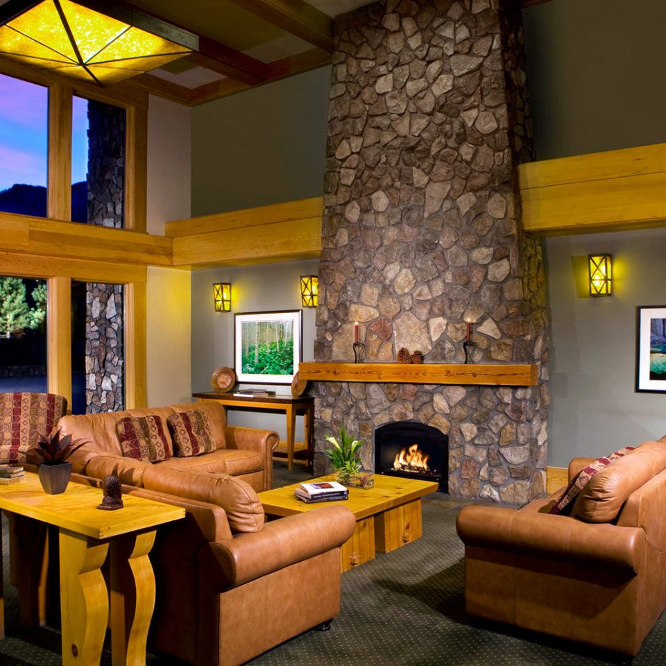 Fireplace Lodge sofa property living room recreation room home Resort cottage Villa Suite