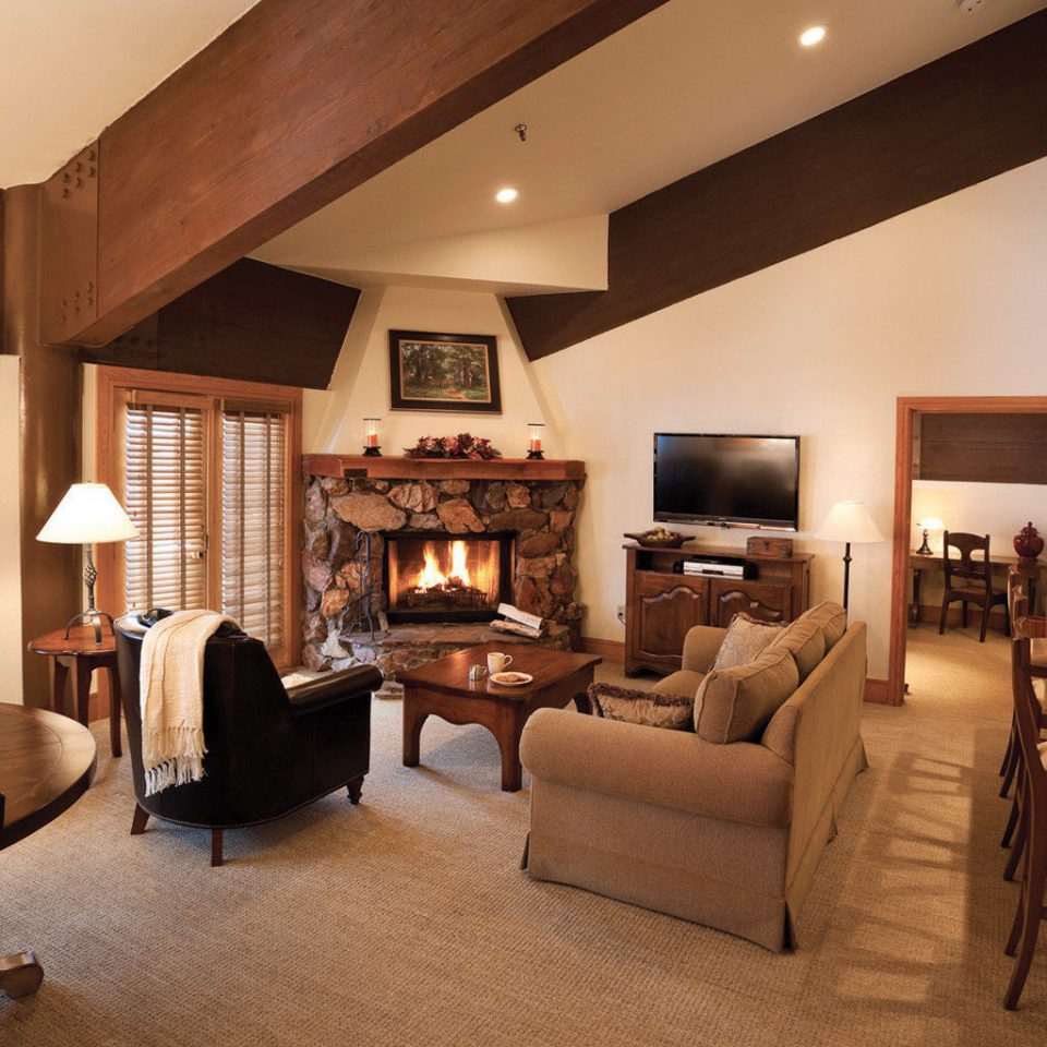 Fireplace Lodge Rustic Suite property living room home hardwood recreation room cottage Villa mansion farmhouse