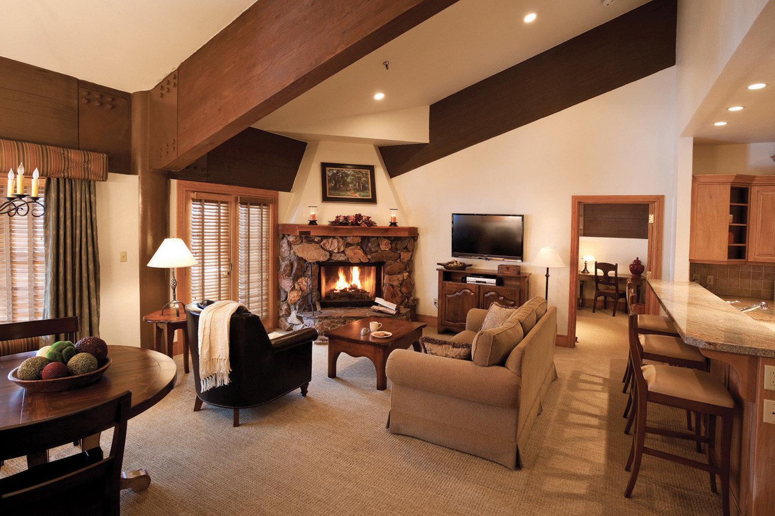 Fireplace Lodge Rustic Suite property living room home hardwood recreation room cottage Villa mansion farmhouse