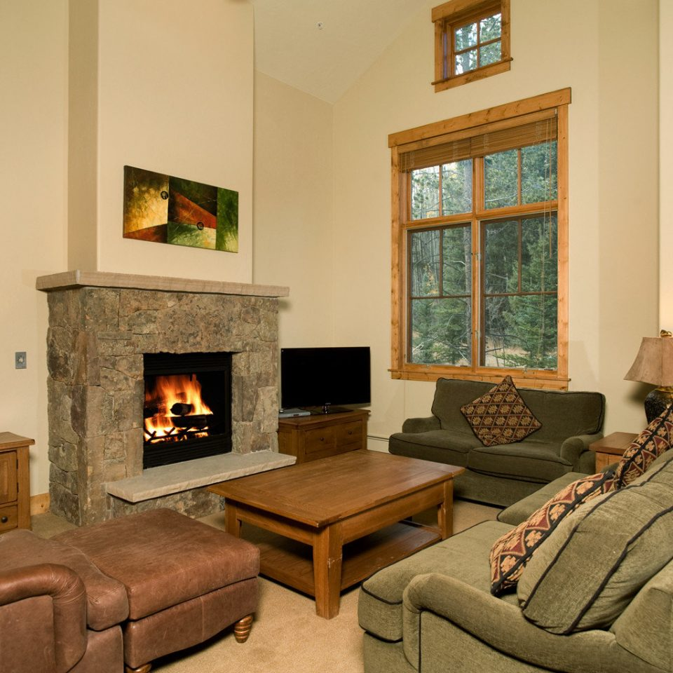 Fireplace Lodge Rustic living room property home house hearth hardwood cottage Villa farmhouse mansion wood flooring stone