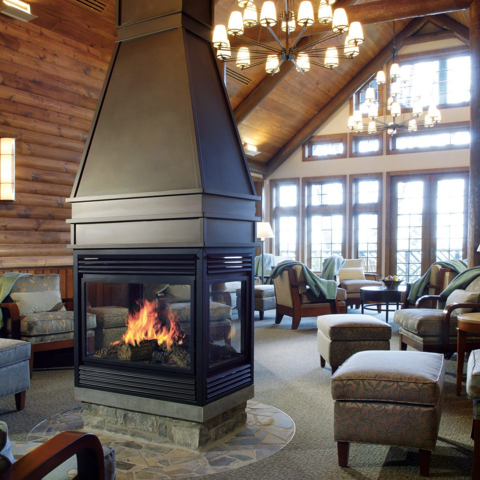 Fireplace Lounge Modern Resort chair living room property home house cottage hearth farmhouse Villa