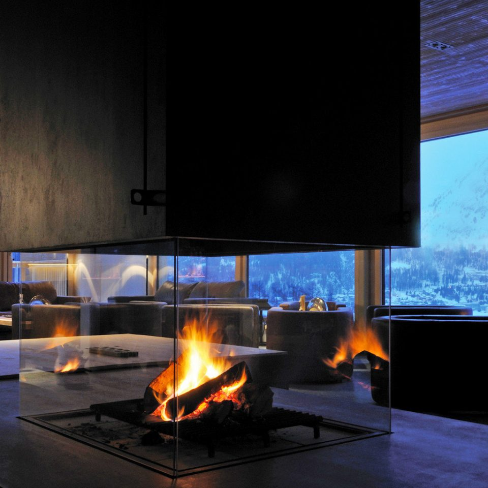 Fireplace Lounge Mountains Resort Scenic views building fire light hearth lighting screenshot living room