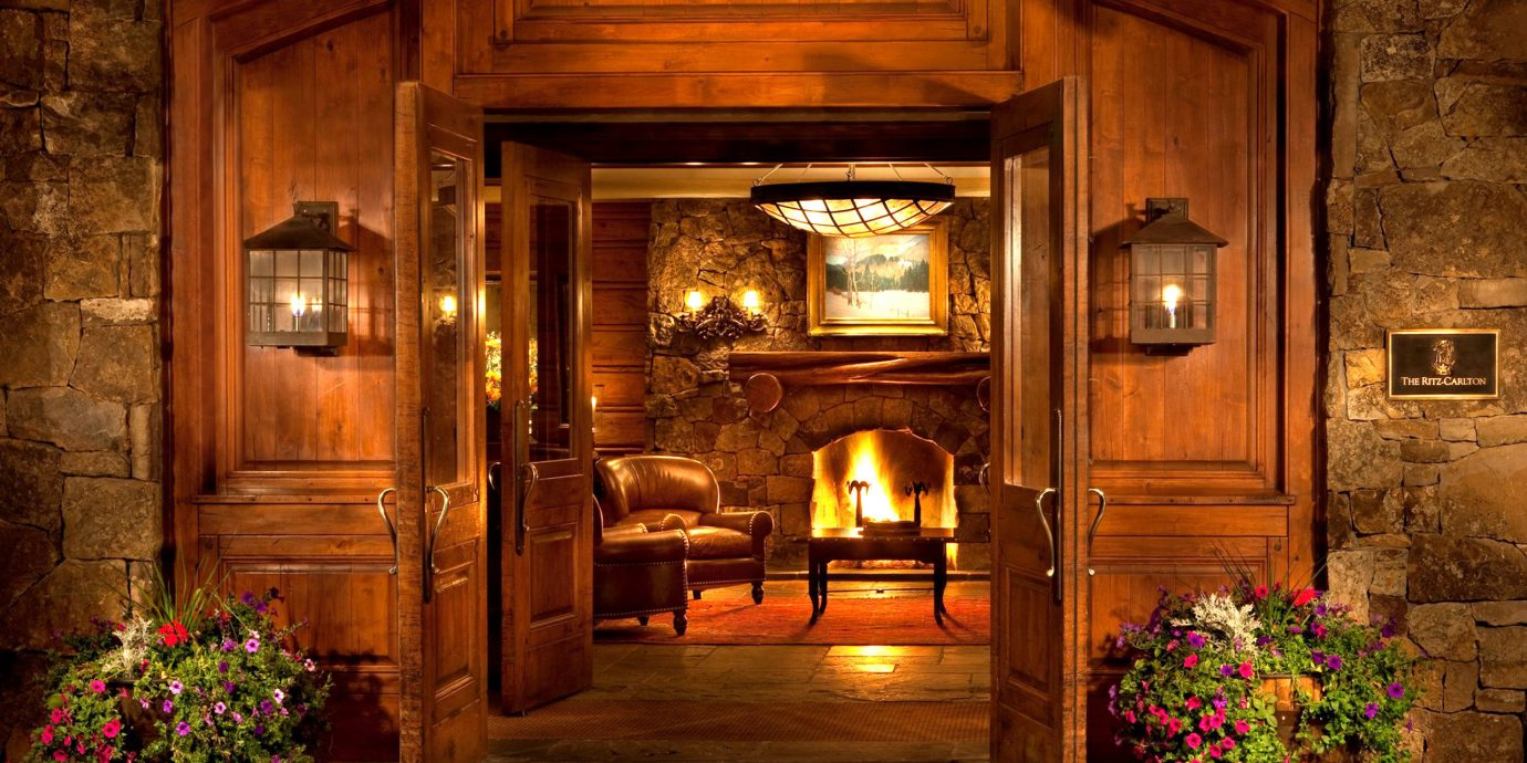 Fireplace Lounge Resort fire building house mansion home lighting screenshot landscape lighting log cabin living room stone