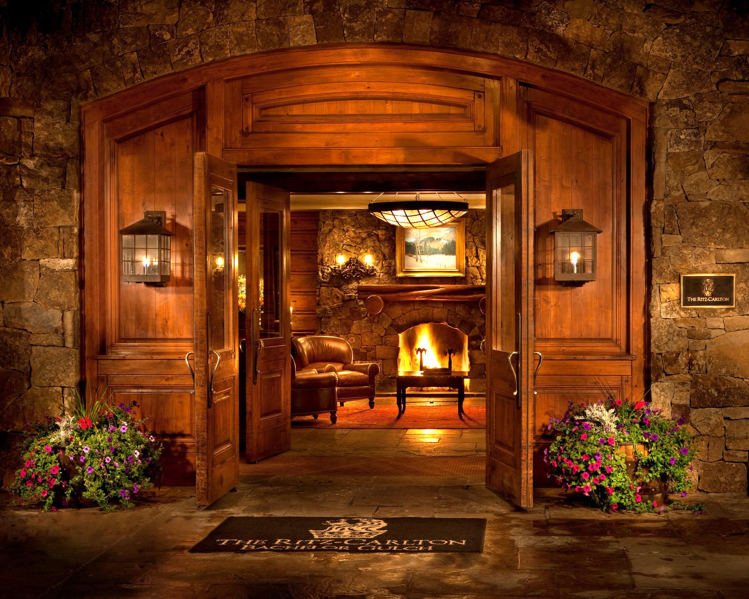 Fireplace Lounge Resort fire building house mansion home lighting screenshot landscape lighting log cabin living room stone