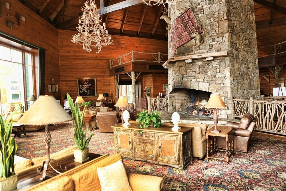 Fireplace Lounge Resort property old home cottage farmhouse living room restaurant stone