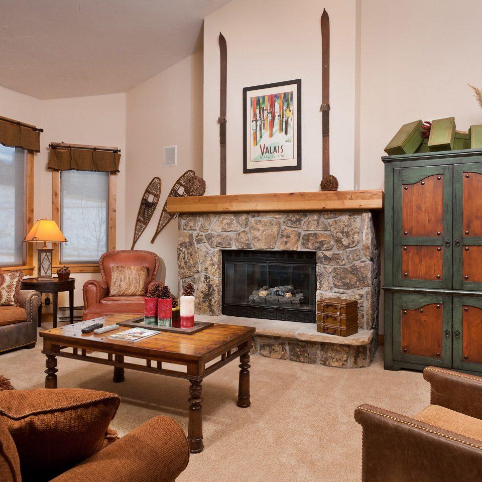 Fireplace Lounge sofa living room property home hardwood cottage Suite Villa