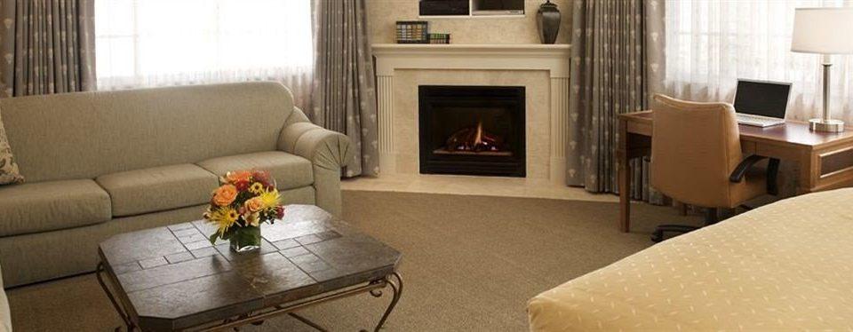 Lounge Suite sofa living room property home Fireplace cottage hardwood curtain Villa condominium flat containing