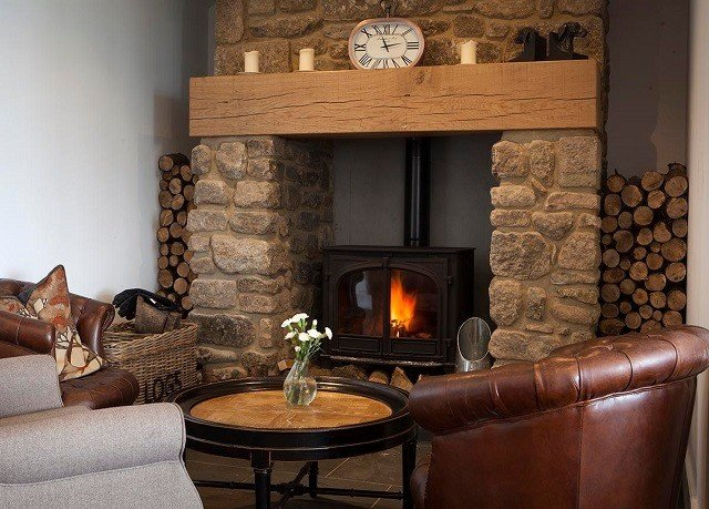 sofa Fireplace hearth chair living room Nature home hardwood wood burning stove cottage stone