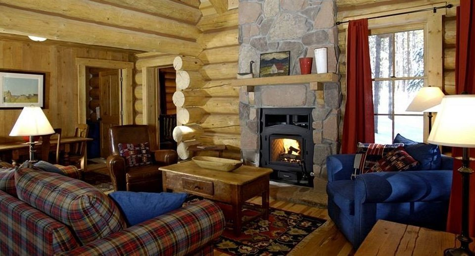 Fireplace Ranch Resort Rustic sofa property chair living room cottage home log cabin Suite farmhouse Villa