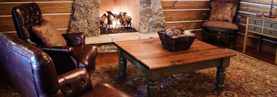 Fireplace Ranch Resort Rustic wooden living room hardwood seat cottage old leather stone