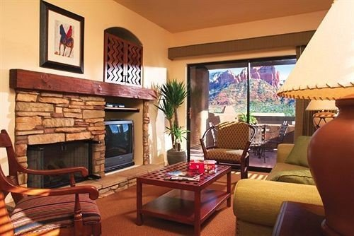 property Fireplace living room Villa Resort home cottage condominium Suite hacienda