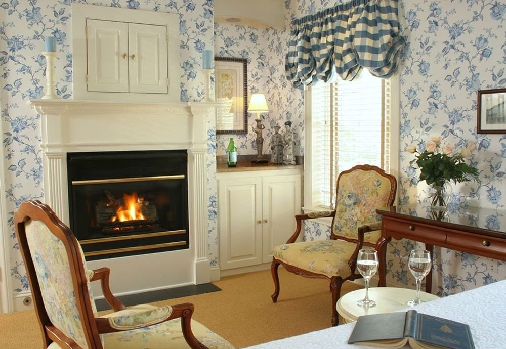 Fireplace Romantic living room fire property chair home cottage hearth Villa farmhouse mansion