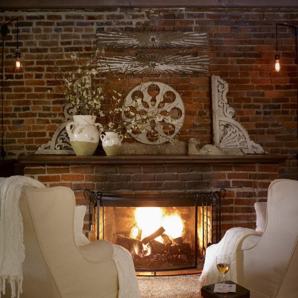 living room Fireplace home lighting hearth brick flooring light fixture Suite interior designer lighting accessory stone