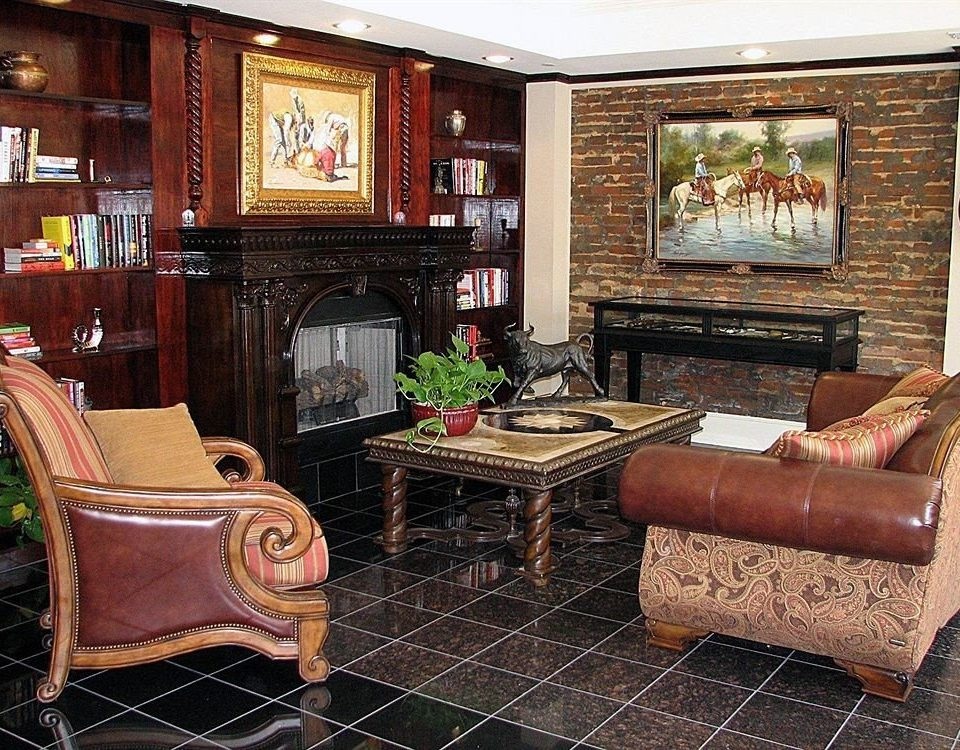living room property chair home Fireplace hardwood cottage cabinetry recreation room Suite mansion leather stone