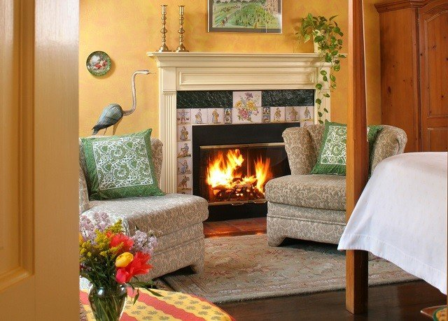 sofa Fireplace living room property fire home cottage hardwood Suite wood flooring stone