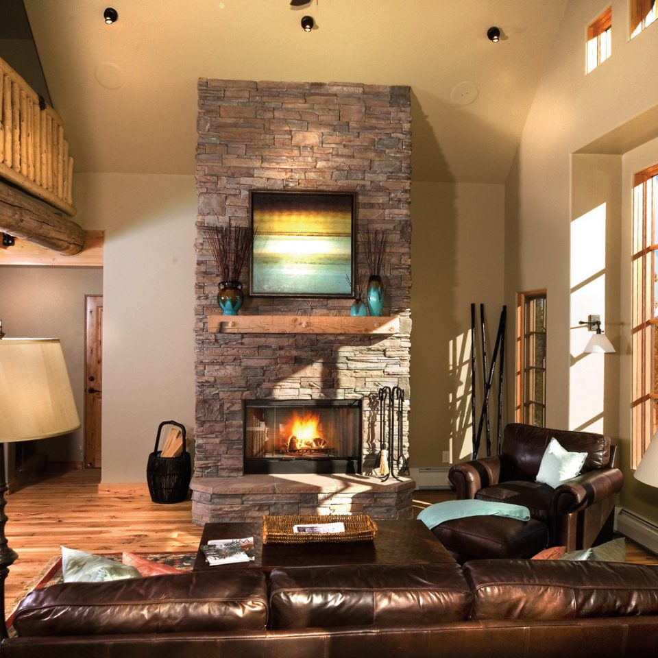 sofa living room property home hardwood Fireplace lighting cottage Suite mansion recreation room leather