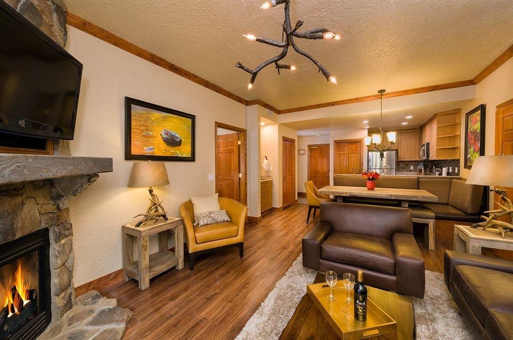 sofa Fireplace property living room home recreation room Suite hardwood mansion cottage Villa condominium stone flat