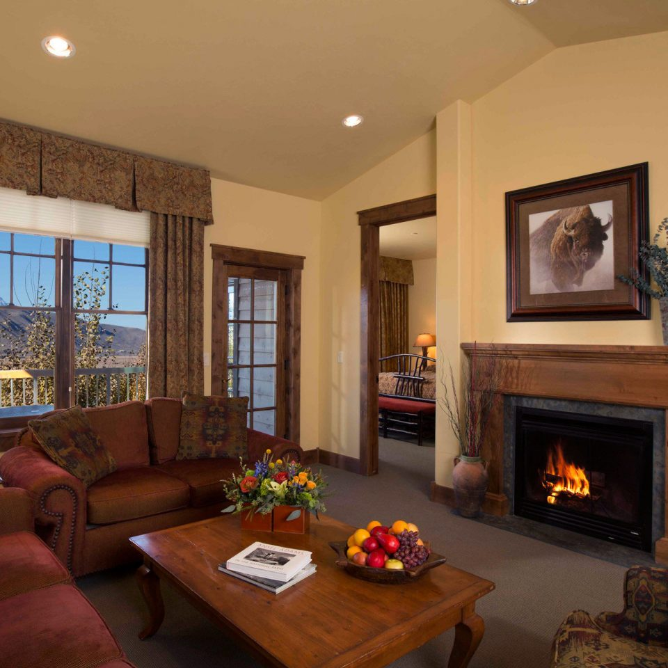sofa Fireplace fire living room property home hardwood cottage Suite mansion Villa flat leather