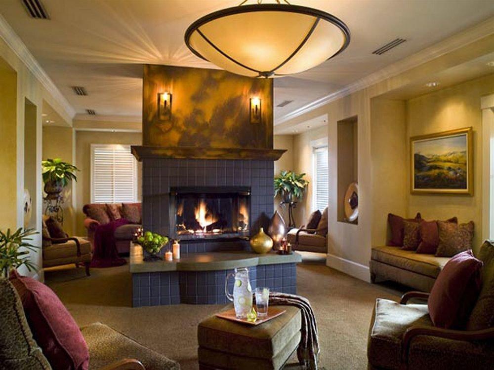 sofa living room Fireplace property home hardwood mansion Suite Villa cottage