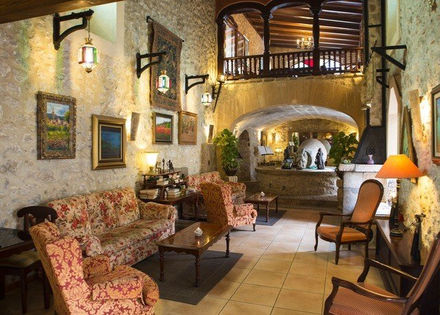 chair property living room building Fireplace Villa home cottage mansion hacienda farmhouse